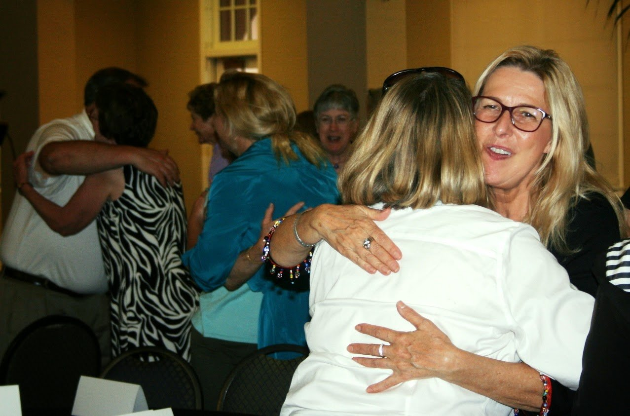 Reducing Stress: Attendees hug for 20 seconds